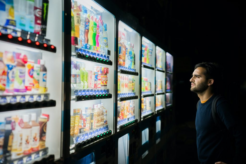 Man has difficulty what bottle to choose because of self-doubt